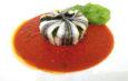 Tortino di acciughe su salsa di pomodoro