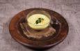Crema di Zucchette Trombette con Seppie al Nero e Scorzette Candite di Limoni